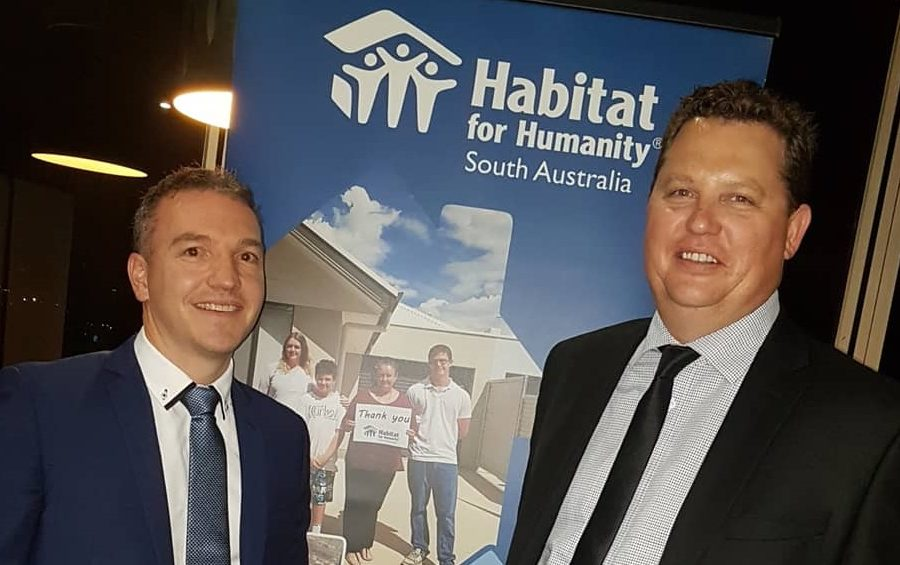 Raising the roof to congratulate long-term client, Habitat For Humanity image